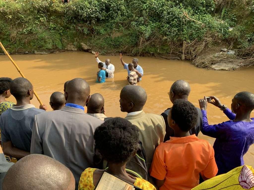 standing in river praying